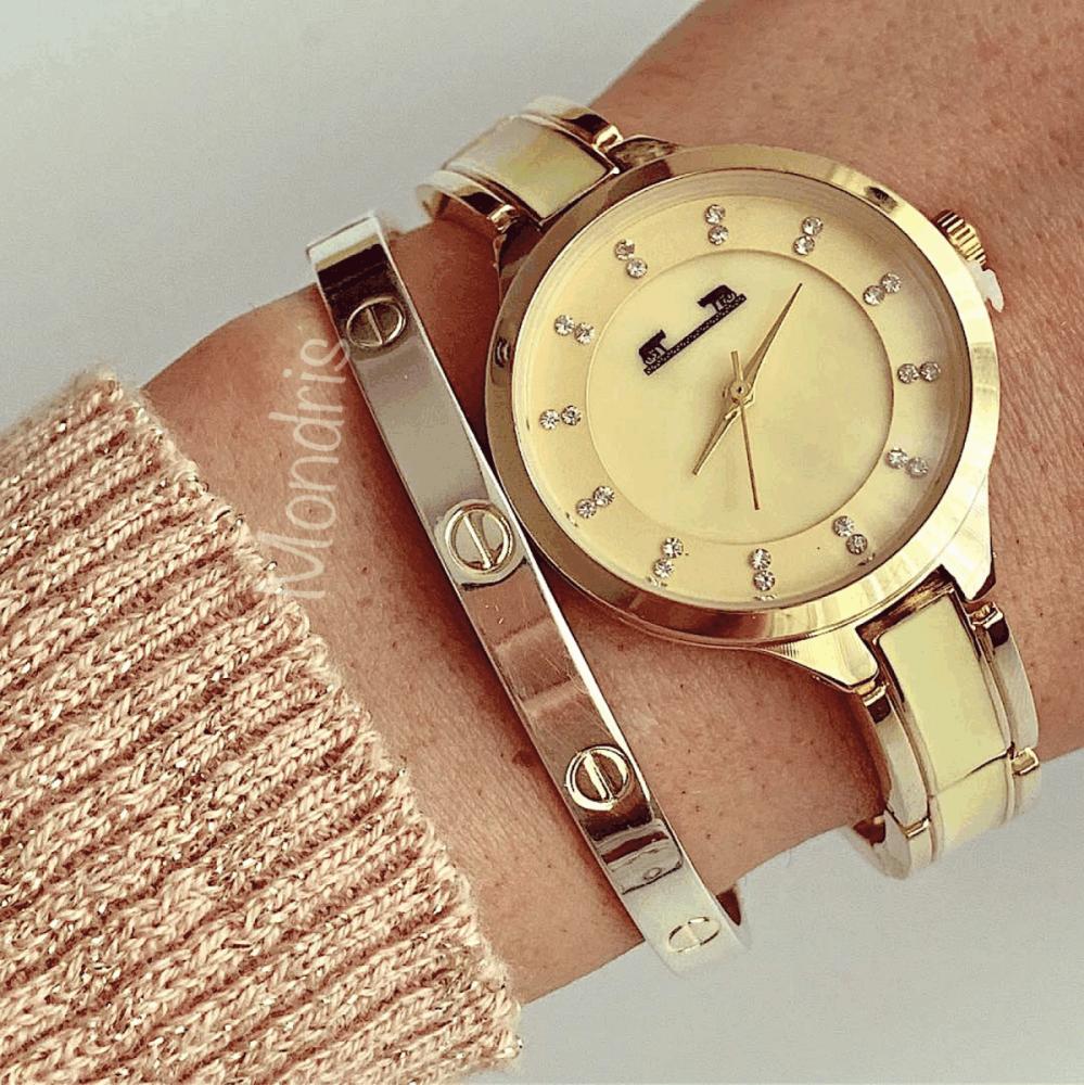 Ceas dama auriu minimalist cu bratara metalica si detalii interesante